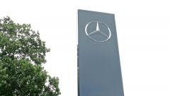 View of the mercedes logo on the board next the big tree in the countryside Stock Footage