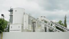 View of the large factory in the evergreen countryside - cloudy day Stock Footage