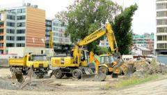 View of the work vehicles in construction site in the city - cloudy day Stock Footage