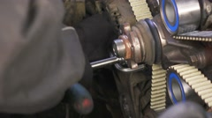 Mechanic making car engine reparation works. Close up. Stock Footage