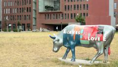 View of the business building in the center of the city - sculpture of a buffalo Stock Footage