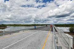 Road bridge over Kamchatka River. Russia, Far East - stock photo