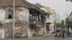 Stock Video Footage of Bicycle rickshaw with old buildings,Semarang,Java,Indonesia