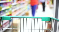 shopping wagon cart moving through store with wom - stock footage