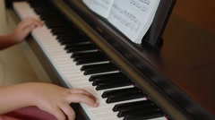 Small child singing piano Stock Footage