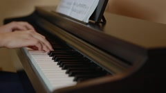 Young hands singing chopin opus Stock Footage