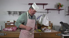 A butcher sharpens his knife Stock Footage