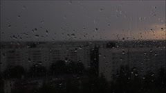 Quiet summer rain pouring down on the glass.  Closeup. Stock Footage