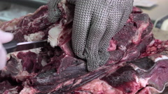A butcher cutting meat cubes Stock Footage