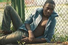 Fashion portrait stylish young african torso man outdoors, vintage colors - stock photo