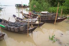 Fishing boats on Ywe River in Myanmar Stock Photos