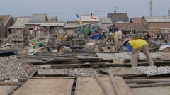 Man putting fish to dry in fishing harbour,Semarang,Java,Indonesia Stock Footage