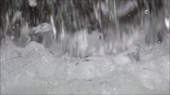 Stock Video Footage of Close up of Water flows out of the tube one reservoir to another.