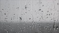 Heavy summer rain pouring down on the glass. Closeup. - stock footage