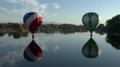 Hot Air Balloons With Reflections On River Stock Footage