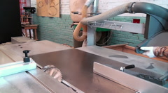Stock Video Footage of Installing the collector chips of saws woodworking machine.