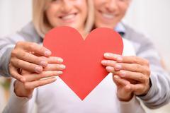 Agreeable couple celebrating St Valentine day Stock Photos