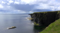 Establishing shot of the beautiful green coast of Scotland or Ireland. Stock Footage
