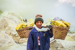 Unidentified Sulfur miners - stock photo