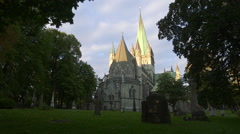 Nidaros Cathedral church Trondheim Norway distant view backyard with graves - stock footage