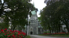 Nidaros Cathedral church Trondheim Norway side view foreground flowers Stock Footage