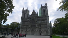 Nidaros Cathedral church Trondheim Norway front view tourists Stock Footage