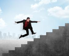 Business person jump to the highest stair Stock Photos