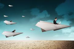 Business people race with paper plane going for better career Stock Photos