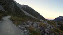 Hiking At Hooker Valley Track, Pan Right To Sunset View At Tasman Valley - stock footage