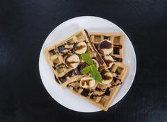 Waffles with Bananas and Chocolate Sauce - stock photo