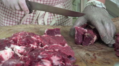 a butcher cutting meat cubes - stock footage