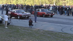 Street race on a Swedish road with extreme cars Stock Footage