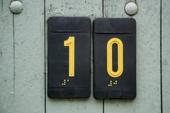 Door number sign plate with braille - stock photo