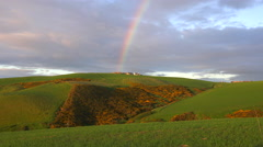 A beautiful rainbow forms over the land in Scotland or Ireland. Stock Footage