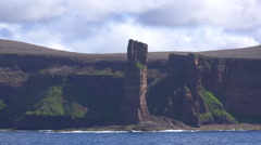 The old man of hoy rock formation in the Orkney Islands of Great Britain. - stock footage