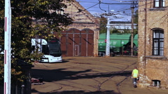 Of passing freight train composition to the old tram depot background Stock Footage
