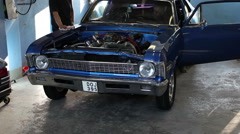 Try to start a Chevrolet Nova in a garage Stock Footage
