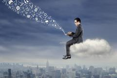 Entrepreneur working with laptop on the cloud Stock Photos