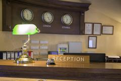 Hotel front desk with focus on reception sign - stock photo