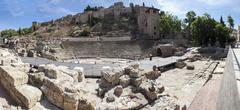 Ancient Roman amphitheatre ruins in Malaga, Spain Stock Photos