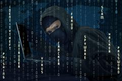Hacker stealing laptop and breaking the security system Stock Photos