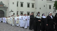 Sisters monks and priests march in religious procession near cathedral. 4K Stock Footage