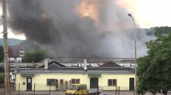 Black dense smoke fire in old storage in town . 4K Stock Footage