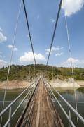 Stock Photo of Metal pedestrian suspension bridge