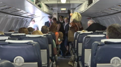 Passengers getting off flight Stock Footage