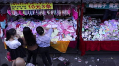 Underwear clothing stalls in a small commodities market Stock Footage