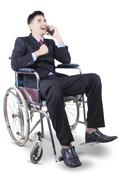 Successful handicapped man talking on the phone - stock photo