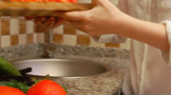 Woman making a salad with fresh vegetables, preparing tomatoes Stock Footage