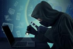 Thief steal user identity on the laptop - stock photo
