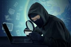 Thief with credit card stealing user identity - stock photo